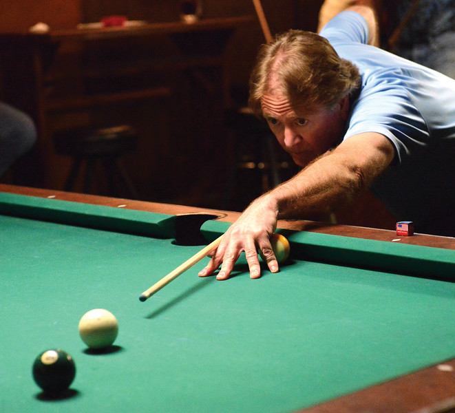 Bud Denega | The Sheridan Press<br /> Phil Compton eyes a shot during the Northern Division billiards tournament Sunday at Beaver Creek Saloon.
