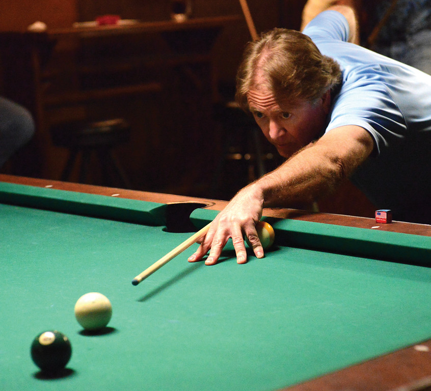 Bud Denega | The Sheridan Press<br /> Phil Compton eyes a shot during the Northern Division billiards tournament Sunday at Beaver Creek Saloon.