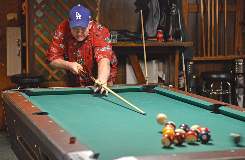 Bud Denega | The Sheridan Press<br /> Clint Doyle breaks to open a pool game during the Northern Division tournament Sunday at the Beaver Creek Saloon.
