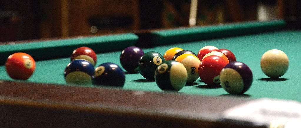 Bud Denega | The Sheridan Press<br /> Pool balls disperse after an opening break during the Northern Division biliards tournament Sunday.