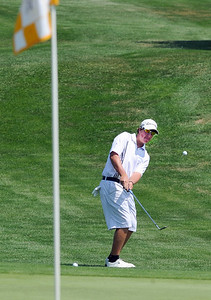 Bridger Ryan, of Broomfield High School, hits  toward the green at  hole one during the Northern League Golf Tournament on Friday. Cliff Grassmick  / August 10, 2012