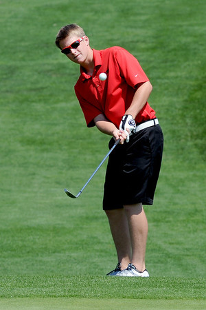 Nick Inslee, of Centaurus High School, hits  toward the green at  hole one during the Northern League Golf Tournament on Friday.<br /> Cliff Grassmick  / August 10, 2012