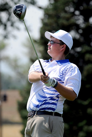 Seth Dykema, of Longmont High School, tees off at hole 2 during the Northern League Golf Tournament on Friday.<br /> Cliff Grassmick  / August 10, 2012