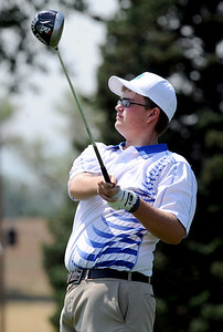 Seth Dykema, of Longmont High School, tees off at hole 2 during the Northern League Golf Tournament on Friday. Cliff Grassmick  / August 10, 2012