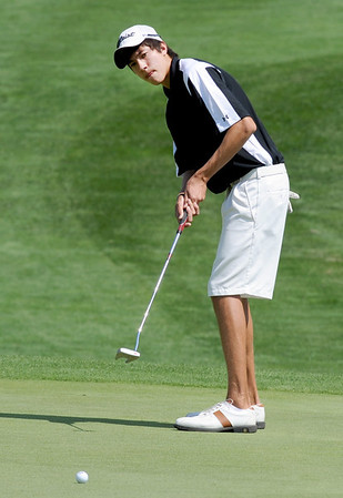 Jack Adolfson, of Niwot High School, hits  toward the green at  hole one during the Northern League Golf Tournament on Friday.<br /> Cliff Grassmick  / August 10, 2012
