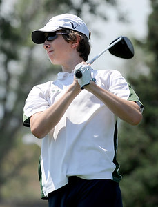 Luke Toillion, of Niwot High School, tees off at hole 2 during the Northern League Golf Tournament on Friday. Cliff Grassmick  / August 10, 2012