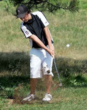 Dylan Wonnacott, of Silver Creek High School, hits out of the rough at hole one during the Northern League Golf Tournament on Friday.<br /> Cliff Grassmick  / August 10, 2012