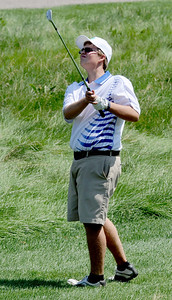 Seth Dykema, of Longmont High School, hits toward hole one  during the Northern League Golf Tournament on Friday. Cliff Grassmick  / August 10, 2012