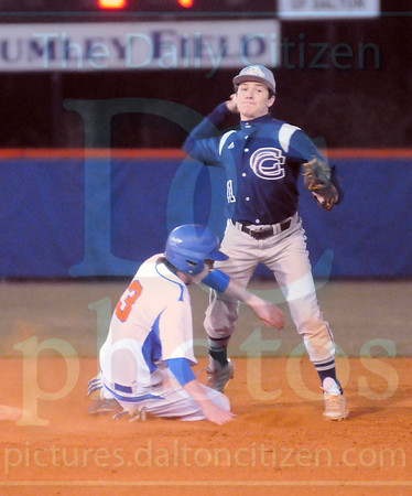 Matt Hamilton/The Daily Citizen<br /> NW3 breaks up the double play as CC11 makes the throw to first Friday.