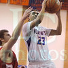 Matt Hamilton/The Daily Citizen<br /> N23 drives to the hoop as D45 defends.