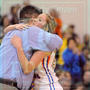 Matt Hamilton/The Daily Citizen<br /> NW43 hugs her coach as she comes off the court in the fourth quarter Thursday.