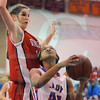 Matt Hamilton/The Daily Citizen<br /> N44 looks to put back the rebound as D40 defends Thursday.