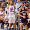 Matt Hamilton/The Daily Citizen<br /> NW24 watches her 3-point shot arc towards the basket Tuesday.