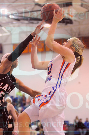 Matt Hamilton/The Daily Citizen<br /> NW43 Mallory Souther puts up a shot as L5 Shayla Ludy fouls her as she attempts the block Saturday.