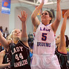 Matt Hamilton/The Daily Citizen<br /> N5 Macy Weeks puts up a shot as L44 Carlie Campbell defends Saturday.