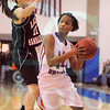 Matt Hamilton/The Daily Citizen<br /> NW44 Bria Clemmons pump fakes and moves around as L11 Hannah O'Shields jumps Saturday.