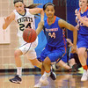 Matt Hamilton/The Daily Citizen<br /> NW44 takes off down the court as RR24 gives chase.