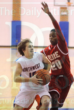 Matt Hamilton/The Daily Citizen<br /> R20 defends as NW10 drives to the basket.