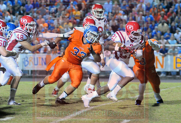 Matt Hamilton/The Daily Citizen<br /> D21 bursts through the line and picks up some yards as NW33 and NW3 defend Friday.