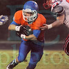 Matt Hamilton/The Daily Citizen<br /> LFO54 can't hang on to SE28 as he twists and scrambles for yards Friday.