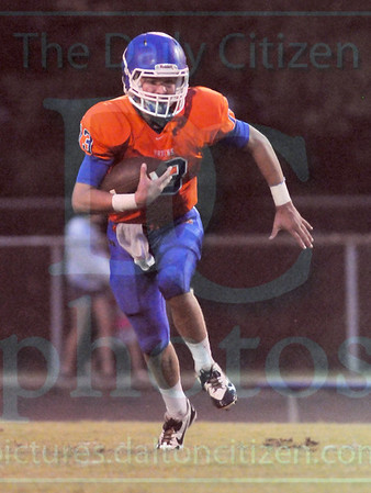 Matt Hamilton/The Daily Citizen<br /> NW13 tucks the ball and runs downfield Friday.
