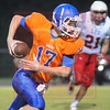 Matt Hamilton/The Daily Citizen<br /> NW17 tucks the ball and runs for a TD Friday.