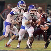 Matt Hamilton/The Daily Citizen<br /> NW28 takes the handoff from NW13 as H23 goes for a tackle Friday.