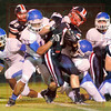 Matt Hamilton/The Daily Citizen<br /> NW11 grabs H1 as he is swarmed by Bruins Friday.