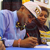 Matt Hamilton/The Daily Citizen<br /> Isaiah Mack signs with UTC Wednesday at Northwest High.