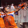 Matt Hamilton/The Daily Citizen<br /> NW cheerleader T.J. Rounsaville, 15, throws a ball to the fans after a Bruins score Friday.