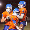 Matt Hamilton/The Daily Citizen<br /> NW56, 1 and 2 celebrate after NW 1 scored a TD Friday.