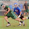 Matt Hamilton/The Daily Citizen<br /> MC Austin Gossett heads towards the endzone as NW Seth Godfrey gives chase Saturday.