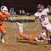 Matt Hamilton/The Daily Citizen<br /> SE9 tries to avoid N5 and N4 as he runs with the ball.