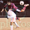 Matt Hamilton/The Daily Citizen<br /> SE19 kicks the ball over his back with his heel as he jumps above NW9.