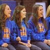 Matt Hamilton/The Daily Citizen<br /> Bayli Cruse, Colby Thomas, Maci Weeks and Mallory Souther react as their state championship rings are presented Tuesday during a pep rally for the softball team at Northwest High.