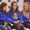 Matt Hamilton/The Daily Citizen<br /> Northwest High seniors Colby Thomas, Maci Weeks and Mallory Souther compare this year's state championship ring with last year's ring Tuesday during a pep rally at the school.