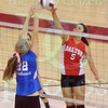 Matt Hamilton/The Daily Citizen<br /> NW22 and D5 meet at the net as they battle for a ball Tuesday at Southeast.