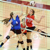 Matt Hamilton/The Daily Citizen<br /> NW8 and D11 battle for a ball at the net Tuesday.