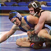Matt Hamilton/The Daily Citizen<br /> A Trace Daitz wrestles NW Timmy Peters in the 132pound match Tuesday.