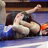 Matt Hamilton/The Daily Citizen<br /> N Austin Taylor wrestles A Ethan Sentell in the 152 pound match Tuesday.