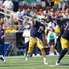 SAM HOUSEHOLDER | THE GOSHEN NEWS<br /> Notre Dame quarterback Jack Coen throws the football against Toledo Saturday at Notre Dame Stadium. Notre Dame won 32-29.