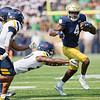 SAM HOUSEHOLDER | THE GOSHEN NEWS<br /> Notre Dame receiver Kevin Austin Jr. runs from Toledo defenders during the game at Notre Dame Stadium Saturday.