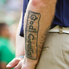 SAM HOUSEHOLDER | THE GOSHEN NEWS<br /> A tattoo on an usher at Notre Dame Stadium is shown during the game against Toledo Saturday.