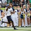 SAM HOUSEHOLDER | THE GOSHEN NEWS<br /> Toledo quarterback Dequan Finn runs into the endzone for a go-ahead touchdown against Notre Dame Saturday. Toledo lost 32-29.