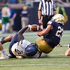 SAM HOUSEHOLDER | THE GOSHEN NEWS<br /> Running back Kyren Williams fumbles after Toledo defensive end Desjuan Johnson forced the ball out during the game Saturday.