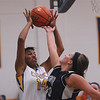 CHBC's Micah Jones and South Central's Macie Cain battle for a rebound Monday.