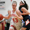 Effingham junior Josie Zerrusen defends from Pana junior Breanna Schoomorer during Effingham's home opener.