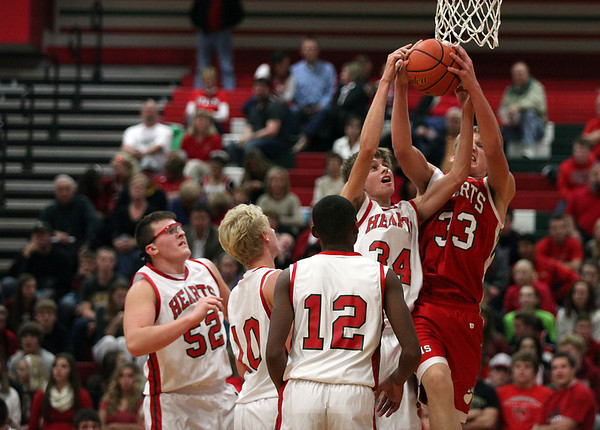 """Isaac Foreman (33) and Kyle Niebrugge (34) battle for a rebound during Effingham High School's """"Meet the Hearts"""" event."""