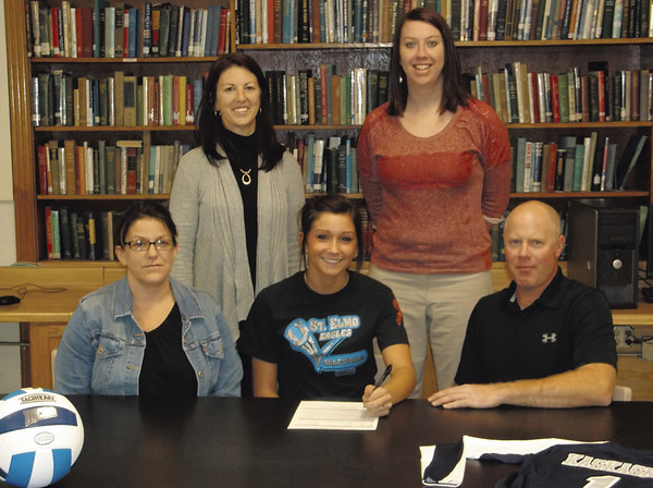 Perry Manley, center, signs a commitment letter to play volleyball at Kaskaskia College next year. St. Elmo coach Elise Asher, Kaskaskia coach Kim Rahar, Shane Healy and Mindy Healy (clockwise from top left) look on.