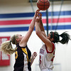 Dieterich sophomore Mallorie Vahling, left, challenges St. Anthony junior Makayla Walsh for a rebound during St. Anthony's 36-38 home loss.